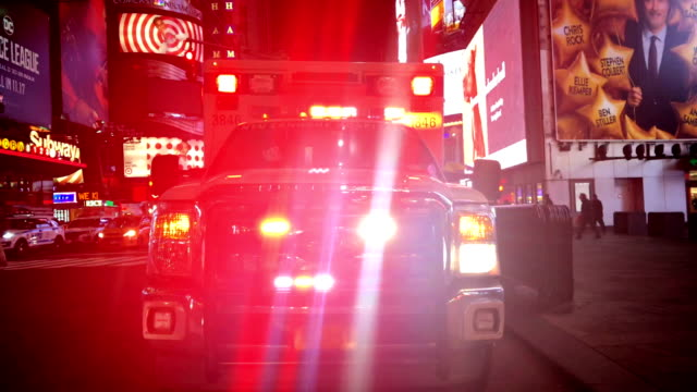 new york ambulance vehicle lights emergency vehicle stands still but the red lights are strobing - ambulanza video stock e b–roll