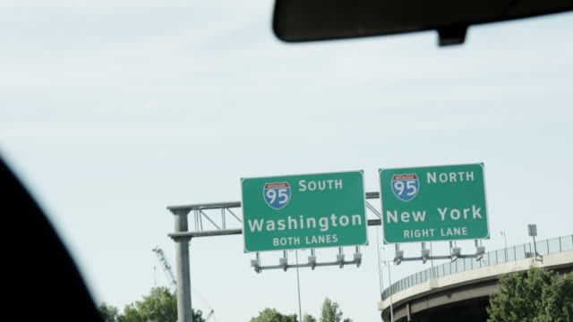 vidéos et rushes de new york and washington signage on highway, pov car ride in slow motion - baltimore
