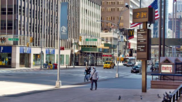 new york avenue street. people walk in mask during pandemic. - broadway manhattan stock videos & royalty-free footage