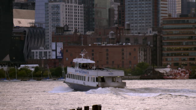 a new york based ferry crosses the hudson river to new york - ferry deck stock videos & royalty-free footage