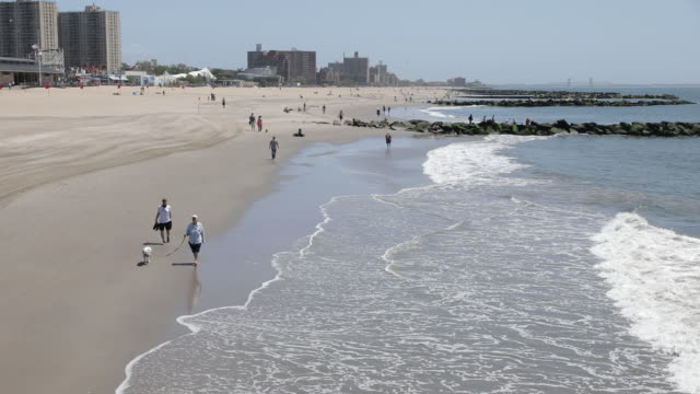 new york beaches reopened after the coronavirus outbreak in new york city ny us on friday may 22 2020 at a press conference on thursday brooklyn... - us memorial day stock videos & royalty-free footage