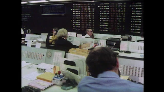 new york bond traders working on phones; 1975 - general view stock videos & royalty-free footage