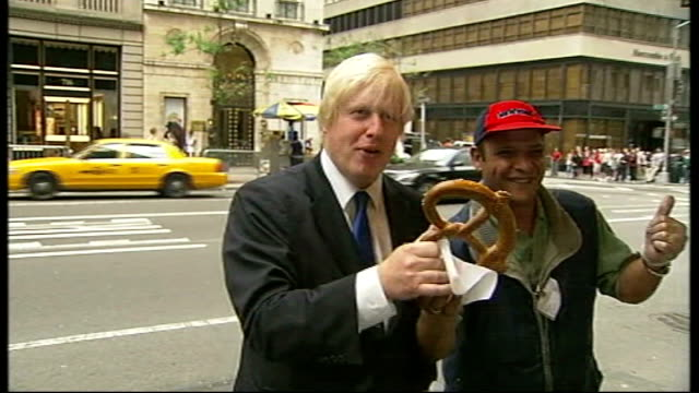 New York Boris Johnson buying pretzel from street vendor and posing for photocall Johnson shaking hands with pretzel seller and away