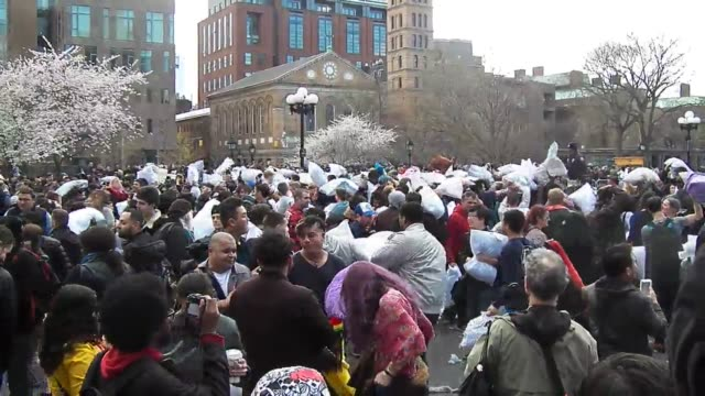broll of a giant pillowfight with hundreds of participants in washington square park which was part of international pillow fight day - pillow fight stock videos & royalty-free footage