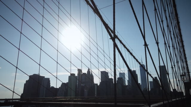 new york brooklyn bridge with nyc skyline in distance featuring one world trade center - high contrast stock videos & royalty-free footage