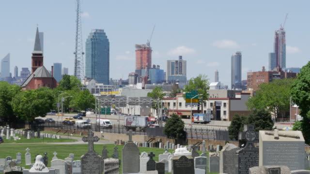 New York Calvary Cemetery,Traffic, and Manhattan Buildings