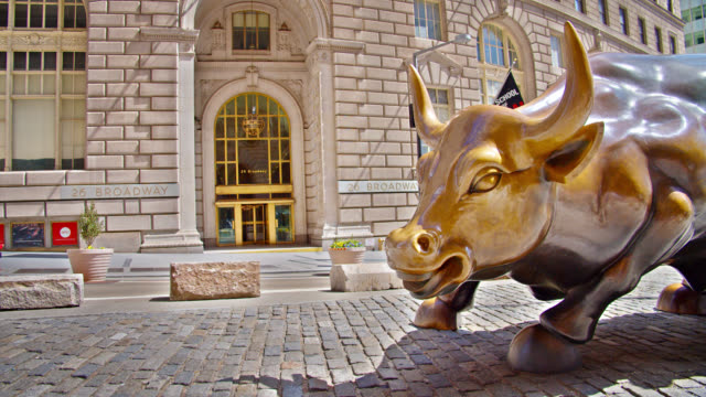 new york charging bull on an empty deserted street. nice sunny day out. financial building. iconic sculpture. famous place. symbol of business and prosperity. - manhattan financial district stock videos & royalty-free footage