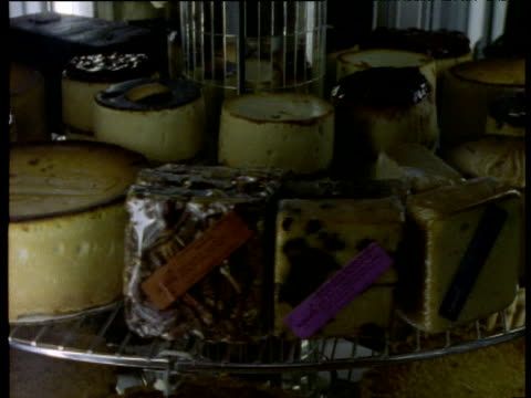 new york cheese cakes rotate around a disco mirrored display cabinet. - display cabinet stock videos & royalty-free footage