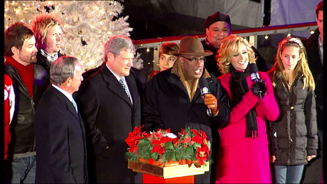 new york city at christmas **music heard over following** good shots of countdown ceremony as christmas tree lights turned on in rockefeller center... - rockefeller center christmas tree stock videos & royalty-free footage