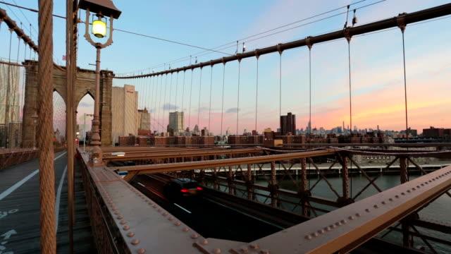 new york city brooklyn bridge at sunrise - brooklyn bridge stock videos & royalty-free footage
