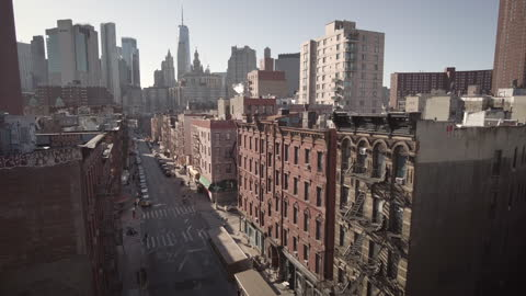 new york city chinatown madison street from the manhattan bridge. high angle view during sunset. one world trade center and the financial district in... - high street stock-videos und b-roll-filmmaterial