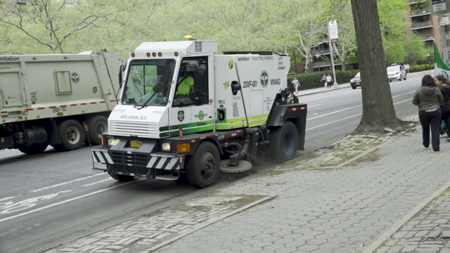 new york city department of sanitation cleans the street of the upper west side , manhattan, new york city, usa. . - dustman stock videos & royalty-free footage