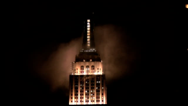 New York City Empire State Building Surrounded by Clouds at Night