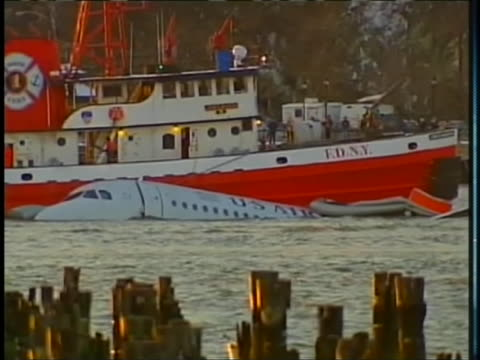 new york city fire department boat passes by the us airways airbus that crashed into the hudson river on january 15, 2009. - river hudson stock videos & royalty-free footage