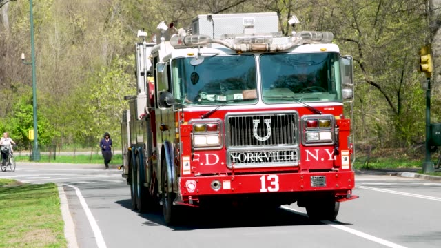 new york city fire department fire engine traverses manhattan's central park amid the outbreak of the coronavirus disease - fire engine stock videos & royalty-free footage