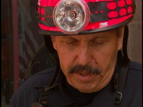 new york city firefighter describes how the department was activated on the morning of the 9-11 terrorist attacks. - firefighter stock videos & royalty-free footage