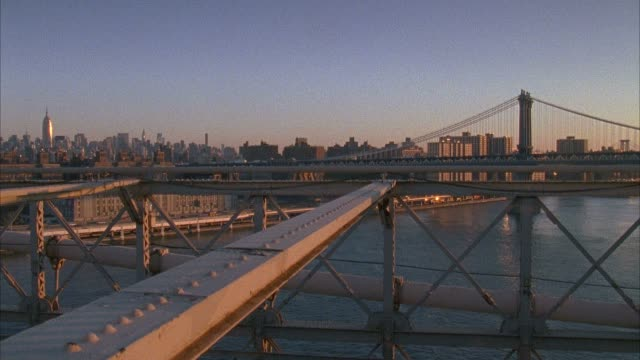 new york city from brooklyn borough side of brooklyn bridge pedestrian & bike path center lane, cars moving below, manhattan bridge &... - brooklyn bridge stock videos & royalty-free footage