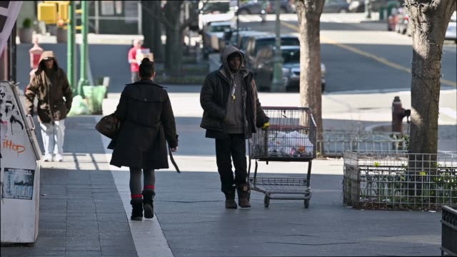 new york city - harlem people walking on the sidewalk in manhattan, man is seen dribbling a basketball, homeless man is seen collecting recyclables... - ハーレム点の映像素材/bロール