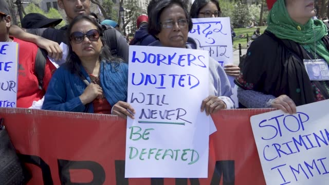 new york city international workers day demonstrators gathered and rallied in washington square park and marched to various neighborhoods in downtown... - uguaglianza video stock e b–roll