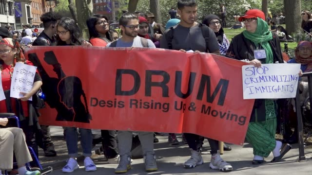 new york city international workers day demonstrators gathered and rallied in washington square park and marched to various neighborhoods in downtown... - socialism stock videos & royalty-free footage