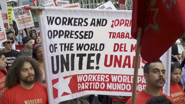 new york city international workers day . demonstrators marched from 14th street union square to foley square in the civic area in downtown manhattan... - socialism stock videos & royalty-free footage