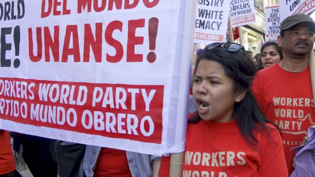 new york city international workers day demonstrators marched from 14th street union square to foley square in the civic area in downtown manhattan... - union square new york city stock videos and b-roll footage