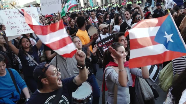 new york city international workers day protestors marched from 14th street union square to foley square in the civic area in downtown manhattan... - may day international workers day stock videos & royalty-free footage