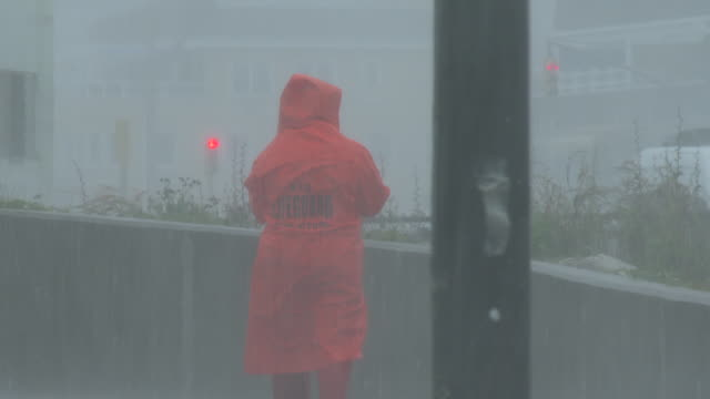 a new york city lifeguard is caught in torrential rain during tropical storm fay on rockaway beach queens new york new york - scott mcpartland stock videos & royalty-free footage