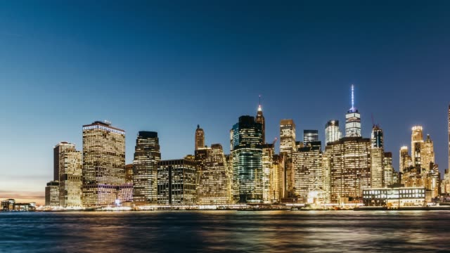 t/l ws zi new york city lower manhattan skyline, dusk to night transition / new york, usa - sequential series stock videos & royalty-free footage