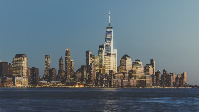 t/l ws tu new york city lower manhattan skyline, from dusk to night / new york, usa - day and night image series stock videos & royalty-free footage