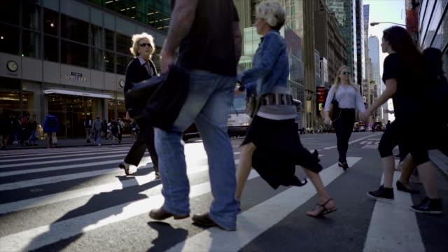 new york city manhattan street scene of people commuting. urban lifestyle background - the americas stock videos & royalty-free footage