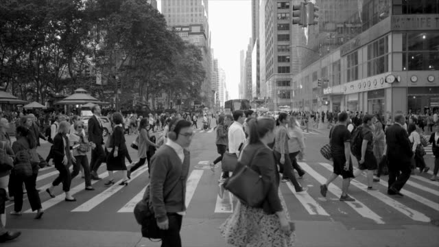 new york city manhattan street scene of people commuting. urban lifestyle background