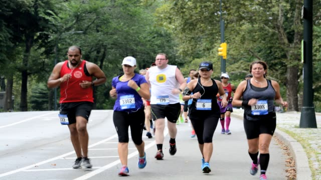 new york city marathon long training run in central park manhattan new york city usa - number 2 stock videos & royalty-free footage