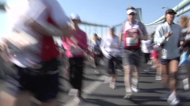la ms pan new york city marathon participants running across verrazano-narrows bridge / new york, ny, usa - 2007 video stock e b–roll