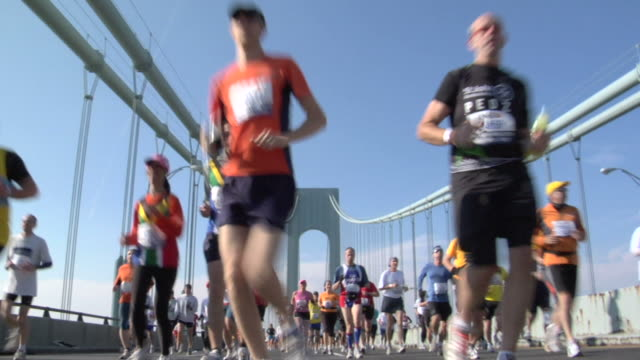 la ws new york city marathon participants running across verrazano-narrows bridge / new york, ny, usa - viking helmet stock videos and b-roll footage