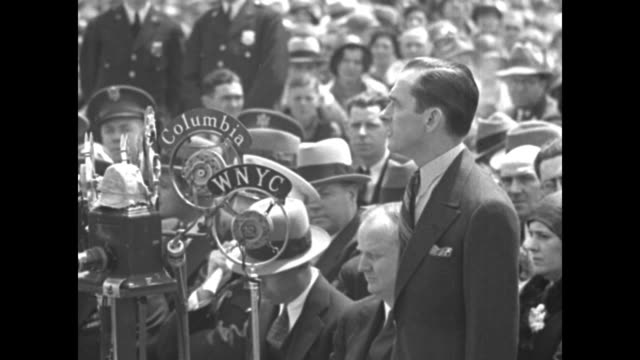 "new york city mayor jimmy walker speaks at opening ceremony of floyd bennett field in brooklyn; ""wnyc"" and ""columbia"" microphones stand in front of... - siero video stock e b–roll"