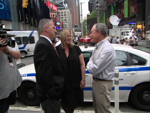 new york city mayor michael bloomberg is in times square to commend new york police department hero cop wayne rhatigan and is talking to both wayne... - crime or recreational drug or prison or legal trial stock videos & royalty-free footage