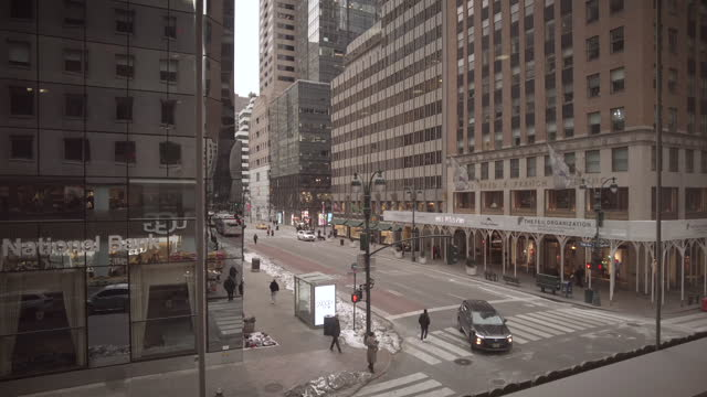 new york city midtown streets and traffic during coronavirus pandemic. high angle view from the 2nd floor looking down at 5th avenue with cars, mta... - yellow taxi stock videos & royalty-free footage