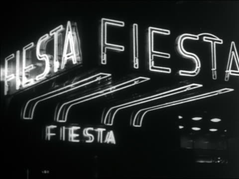 stockvideo's en b-roll-footage met b/w 1938 montage new york city nightclub marquees lit up at night / documentary - 1938