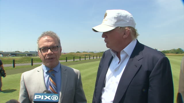new york city official talks about how this project has been going on since the 1970s and it did not see any growth until donald trump stepped in... - golf links stock videos and b-roll footage