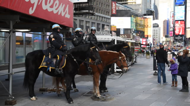 New York City Police Department Mounted Unit at Times Square in New York New York US on January 5 Wide shot of an African America young girl taking...