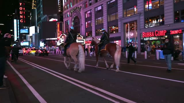 new york city police department mounted units patrol as people gather to watch elections results on election day 2020 in times square on november 03,... - joe 03 stock videos & royalty-free footage