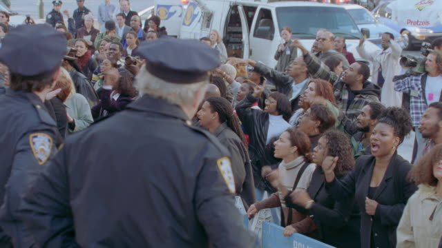 new york city police supervise a public demonstration. - protestor stock videos & royalty-free footage