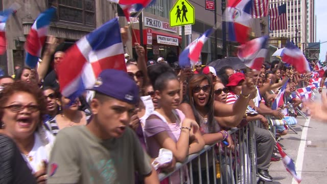 new york city residents celebrate at dominican day parade crowd cheers at dominican day parade on august 11 2013 in new york new york - dominican republic stock videos & royalty-free footage