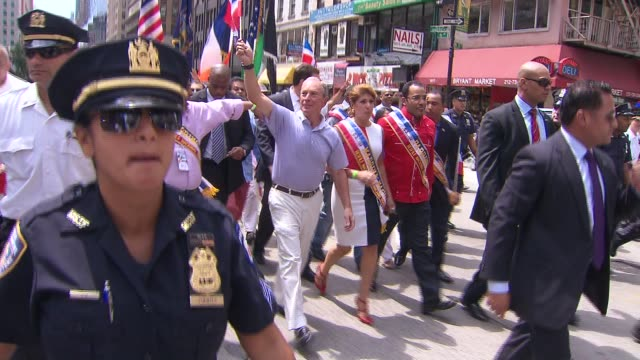 new york city residents celebrate at dominican day parade mayor michael bloomberg waves to crowd on august 11 2013 in new york new york - bürgermeister stock-videos und b-roll-filmmaterial