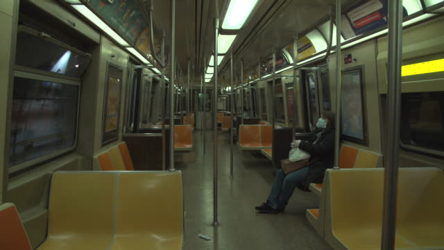 new york city residents on the subway during the coronavirus pandemic lockdown - surgical mask stock videos & royalty-free footage