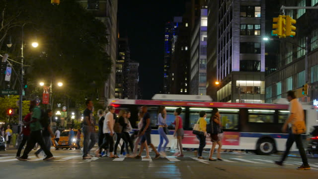 new york city scenery of rush hour commuters walking on the streets. urban lifestyle people background
