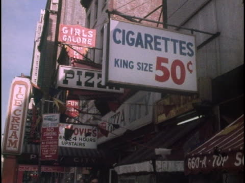 new york city signs in the 1970s advertise cigarettes, food, and girls galore. - cigarette stock videos & royalty-free footage