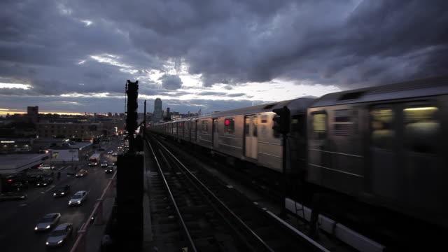New York City Skyline and Subway Train at Sunset