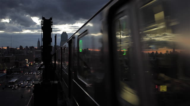 New York City Skyline and Subway Train at Sunset